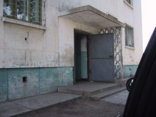 The front door of a Soviet Era apartment building. These still house much of the poplulation in the capital city.